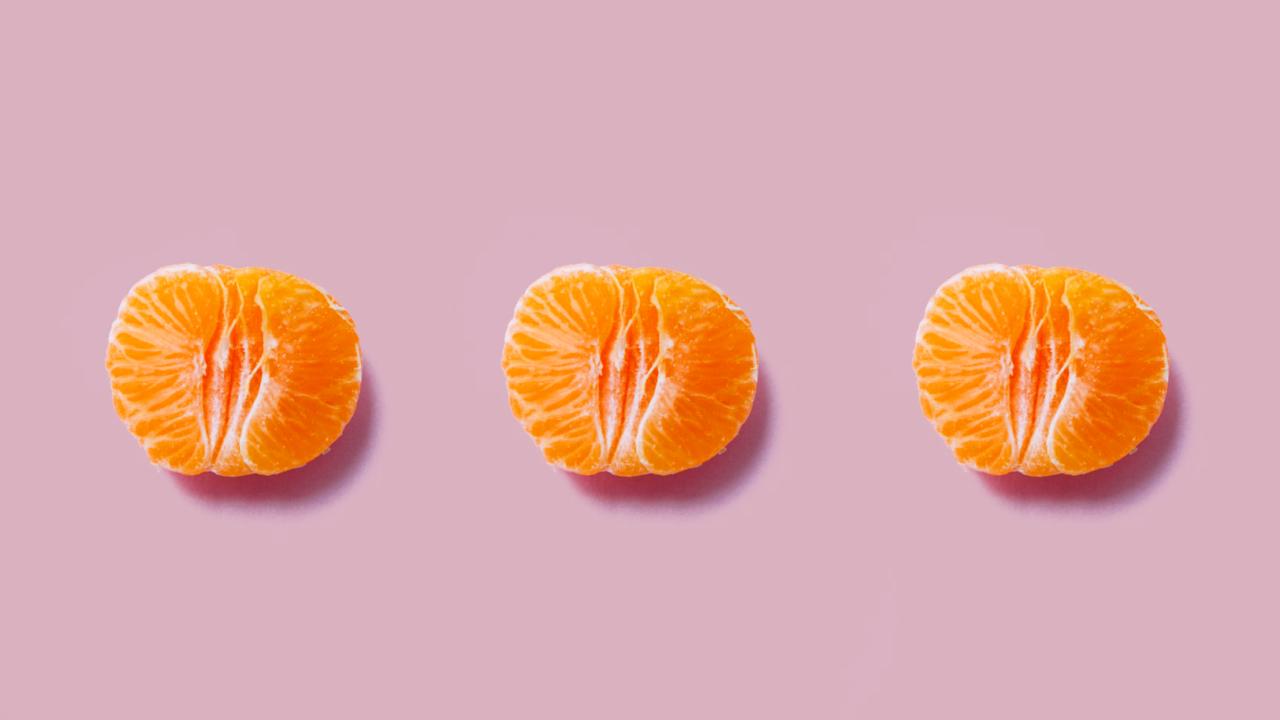 Sensuella mandariner som är delade på mitten likt en vagina